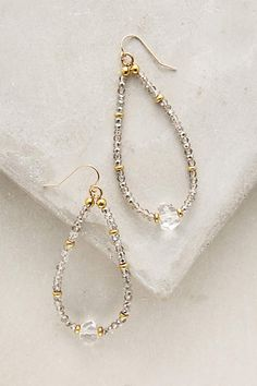 Crystal Teardrop Hoops - anthropologie.com 14k gold fill, cubic zirconium, quartz