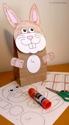 Easy bunny craft template with tags included. The craft also doubles as a bag/basket for gifts for collecting items.