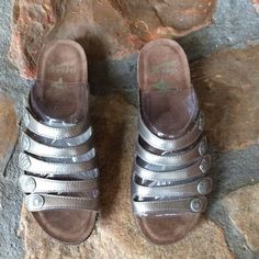 """NWT Dansko Janie Sandals Leather uppers in metallic pewter which is darker than silver. 1.25"""" heel. These fit me well. I usually wear size 8. Dansko Shoes Sandals"""