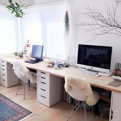 Ikea Alex desk...I like the drawers here and the chairs with faux fur.