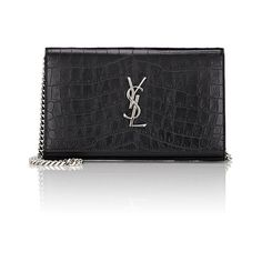 Saint Laurent Monogram Chain Wallet ($1,550) ❤ liked on Polyvore featuring bags, wallets, black, strap bag, logo bags, monogrammed wallet, yves saint laurent and snap closure wallet