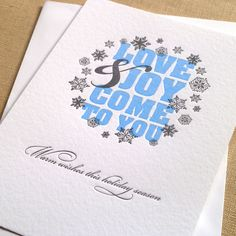 Love & Joy Holiday Card - armatodesign  Letterpress photo card in 2 colors. This card comes with self adhesive photo corners so you can include a 4x6 photo on the back. $230/50 cards.  http://www.etsy.com/shop/armatodesign