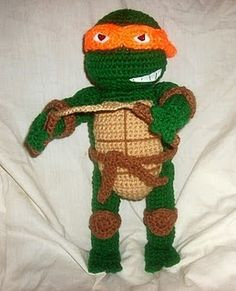 Free Crochet Amigurumi Pattern WolfDreamer: TMNT Michaelangelo This person puts out Mario AND Pokemon patterns. All are amazing and adorable! Crochet Crafts, Crochet Dolls, Crochet Projects, Crochet For Kids, Crochet Baby, Free Crochet, Crotchet, Amigurumi Patterns, Crochet Patterns