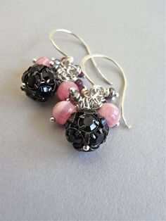 The Damson earrings - vintage jet-black crystal bead balls nestle between freshwater pearls and gemstones - all housed on hand forged sterling ear wires.