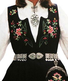 This is a Lundeby costume often worn in the Oppland region it also comes in white