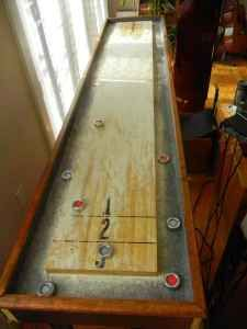 Shuffleboard. Best bar game ever. I like my tables nice and used...