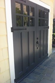 Enemies of carriage doors. Articles about custom swing out carriage house garage doors. Evergreen Carriage Doors builds custom hand crafted authentic antique carriage house doors and carriage garage doors. Carriage Style Garage Doors, Black Garage Doors, Carriage Doors, Painted Garage Doors, Swing Out Garage Doors, Small Garage Door, Barn Door Garage, Side Hinged Garage Doors, Single Garage Door