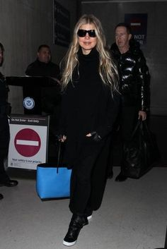 Fergie wearing Giuseppe Zanotti Fergie Sneakers, Fendi Medium Roll Monster Face Embellished Leather Shopper, Baja East Cashmere Ribbed Tunic and Saint Laurent Classic Biker Jacket