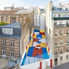 Where to pin this fabulous III-Studio and Pigalle basketball court?   Even non-sports fans will appreciate this colorful basketball court tucked between two apartment building on the rue Duperré in the city's 9th arrondissement. A collaboration between design firm Ill-Studio and French fashion brand Pigalle, the court was inspired by Sportsmen, a 1930s oil painting by Russian artist Kasimir Malevich depicting color-blocked human forms.