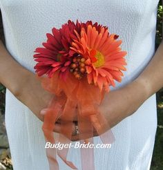 Gerbera Daisy Wedding- this would be cute with 3 of the same and a little greenery, navy ribbon around the stems