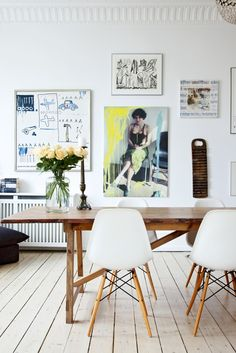 gallery wall, wooden floor, eames DSW chairs