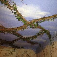 I'd totally do this in the garden instead: Lighted ceiling Trellis, they twinkle at night!