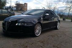 QV badge stands out in Drivetwocity Naousa' s black Alfa Romeo GT.