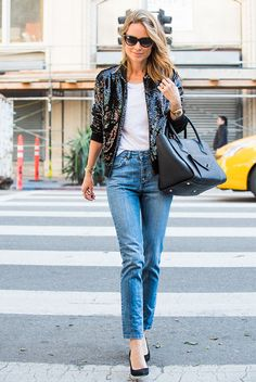 Street Style - The Top Blogger Looks Of The Week: Fashion Blogger 'Anine's World' wearing a black sequin bomber jacket, a white t-shirt, crop jeans, black suede pointy toe heels, black sunglasses and a black handbag