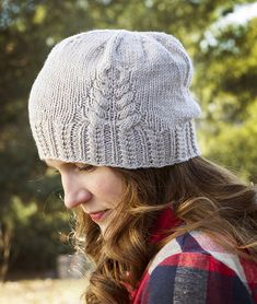 A satisfying, textured brim and cabled pine cone keep this quick little hat interesting and whimsical.
