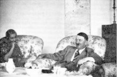 Hitler happy as usual in the Teehaus. This is 1938 and the beautiful Inge Ley is chomping at the bit to get close to Hitler. She never succeeded and committed suicide four years after this photo was taken. Adorable Hitler expression.