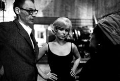 """Marilyn Monroe and Arthur Miller conversing with Louella Parsons on the set of """"Let's Make Love"""", 1960."""