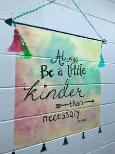 Murals in a middle school bathroom are inspiring girls to be kinder both to