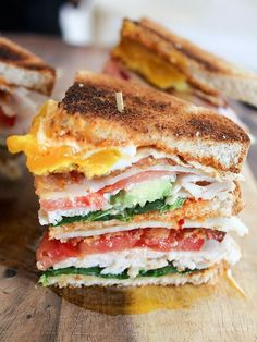 California Club with Chipotle Mayo - Spinach, turkey, tomato, bacon, swiss cheese, fried egg, and avocado