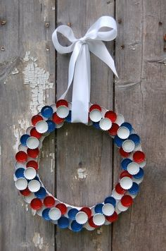 Patriotic wreath made from bottle caps. @Mary Ronquillo-Dawe I also saw this in different shapes and thought this might be a good idea to do with all those bottle caps we have.