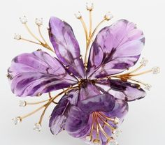 An Arts & Crafts Period Carved Amethyst and Diamond Flower Brooch