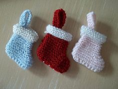 Christmas Stockings pattern by Amanda Berry easy knitting pattern. Could use these mini stockings for an advent calendar. Always wanted to be able to knit, however . Knitted Christmas Decorations, Crochet Christmas Stocking Pattern, Crochet Christmas Gifts, Knitted Christmas Stockings, Christmas Knitting Patterns, Christmas Sewing, Handmade Christmas, Christmas Ornament, Christmas Crafts
