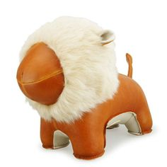 Add a dash of whimsy to your reading sanctuary with this quirky bookend from Zuny. Crafted from tan synthetic leather, this striking lion fi Lion Book, Book Stationery, Cute Plush, All The Colors, Bookends, Camel, Branding Design, Dinosaur Stuffed Animal, Elephant