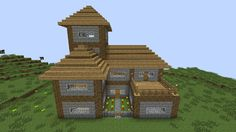 Very nice two floor house in Minecraft with wood and cobblestone.