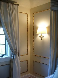 Cool bamboo wall trim and antler drapery tie backs.