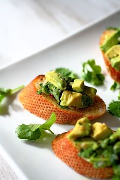 Avocado Bruschetta appetizer for lovers of avocado ! I would add tiny diced red onion and jalapenos to the avocado