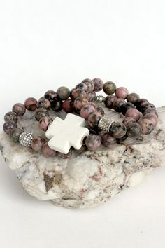 These pink and brown stretch bracelets were handmade in Jacksonville, FL. The variegated stone beads of natural labradorite with silver accents are great for stacking and feature a natural stone cross Cross Jewelry, Diy Jewelry, Beaded Jewelry, Jewelery, Handmade Jewelry, Jewelry Design, Beaded Necklace, Jewelry Making, Beaded Bracelets