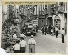 French citizens wave to the first American troops...