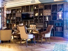 Leather comfy chairs, crate bookshelves, exposed brick and parquet floors, encroached by our Floral Lilac #handmadetiles