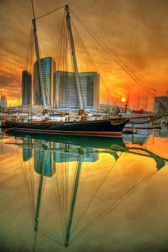 Schooner in San Diego by slack12, via Flickr-Schooner in San Diego   Sunrise over the San Diego Marina. The wonderful colors were produced by the smoke from the fires.