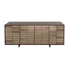 Entertain in refined contemporary style with the Verna buffet by Safavieh Couture. Inspired by artisan-made one of a kind mosaic pieces, this extraordinary buffet is framed in walnut veneer and faced with colored mirror tiles for dining room shimmer.