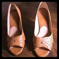 Michael Michael Kors tan open toe pumps Michael Michael Kors tan open toe pumps with gold studs. Worn a couple of times. Heels have scratches shown in picture. No box MICHAEL Michael Kors Shoes Sandals