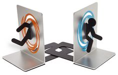 Portal Bookends Take these bookends, they'll hold the books up. Why yes, they do look exactly like a test subject going through a portal on one side and out the portal on the other. Pretty clever, isn't it? Sold on Think Geek.