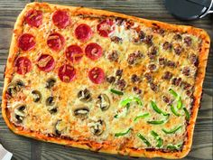 I found this recipe for 30 Minute Family Style Rectangular Pizza, on Breadworld.com. You've got to check it out!