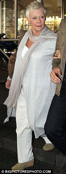I like the carefree, flowy scarf/vest/ in that great shade of blue-grey. judi my favorite fashionista