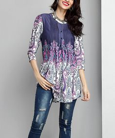 Establish yourself as a pattern maven in this eye-catching tunic with plenty of stretch.Note: Due to the manner in which the fabric is cut, pattern layouts may vary.    Shipping note: This item is made for zulily. Allow extra time for your special find to ship.