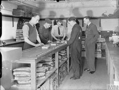 Pilot Officer J Whellens, an RAF armaments officer, at work in the Armoury at Waterbeach, Cambridgeshire, checking the insertion of tracer bullets in ammunition belts. Air Force Bomber, Maximum Effort, Royal Air Force, Bullets, Lancaster, Pilot, Bullet, Pilots