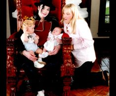 Michael Jackson and Debbie Rowe with their two children Prince Michael (age 1) and Paris in 1998.