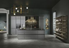 Classic kitchen Frame with micalised lacquered doors in lead grey. #Worktop and back panel in cosmic black #granite. cucine classiche #cucineclassiche #classickitchen #cucinelineari #linearkitchens #Snaidero