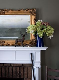 design sponge best of mirrors Elegant with a masculine touch: the ornate Versailles mirror softens the room while rugged pieces like the antique barn chair, 1800s shot gun and cast iron animals in this Hudson Valley home help to add a masculine touch.