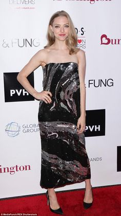 All that glitters! Amanda Seyfried shone in a black-and-silver sequin dress at the K.I.D.S...