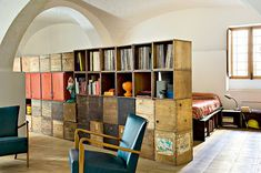 This is the home of an Italian architect who had the idea to use salvaged wooden crates in the interior design to create modular furniture.