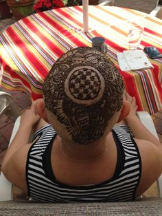 The completed henna design on Lilia Lima's head is entirely free-handed by artist and pre-med student Jeena Karr. Safe, beautiful and fresh, the art gives cancer patients like Lima a new way to feel beautiful.