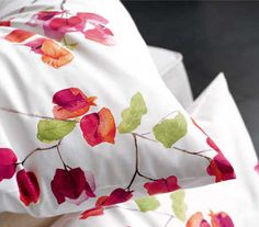 Schlossberg Loraine Grenade Floral Bedding Loraine Grenade Floral print bedding by Schlossberg in 300 thread count. Loraine Shams are available with a knife edge with zipper closure or a flanged edge with envelope back. Loraine Duvet covers have a zipper closure as Schlossberg believes they look better that way, however button closures are available. See Schlossbergs Solid Sateen sheets for coordinating white or solid color sheets. Fabric cuttings available, order below. Made to order…