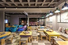 "Love the ceiling and the idea of a ""media room"". Alaloum Board Game Café / Triopton Architects"