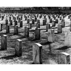 Row of tombstones in cemetery Canvas Art - (18 x 24)
